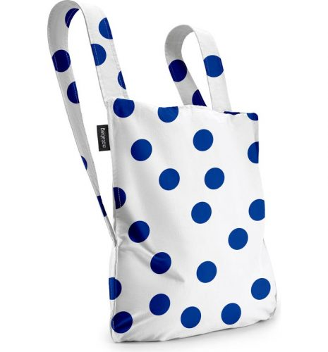 A tote bag with blue polka dots.