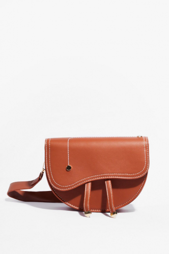 small brown saddle bag with asymmetrical flap from Nasty Gal
