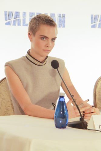 Cara Delevingne with short buzzed hair