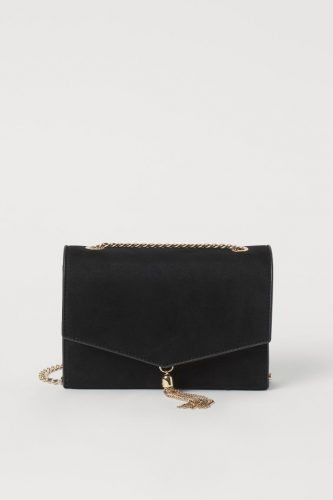 Timeless bag: black crossbody bag with gold tassel and chain strap from H&M