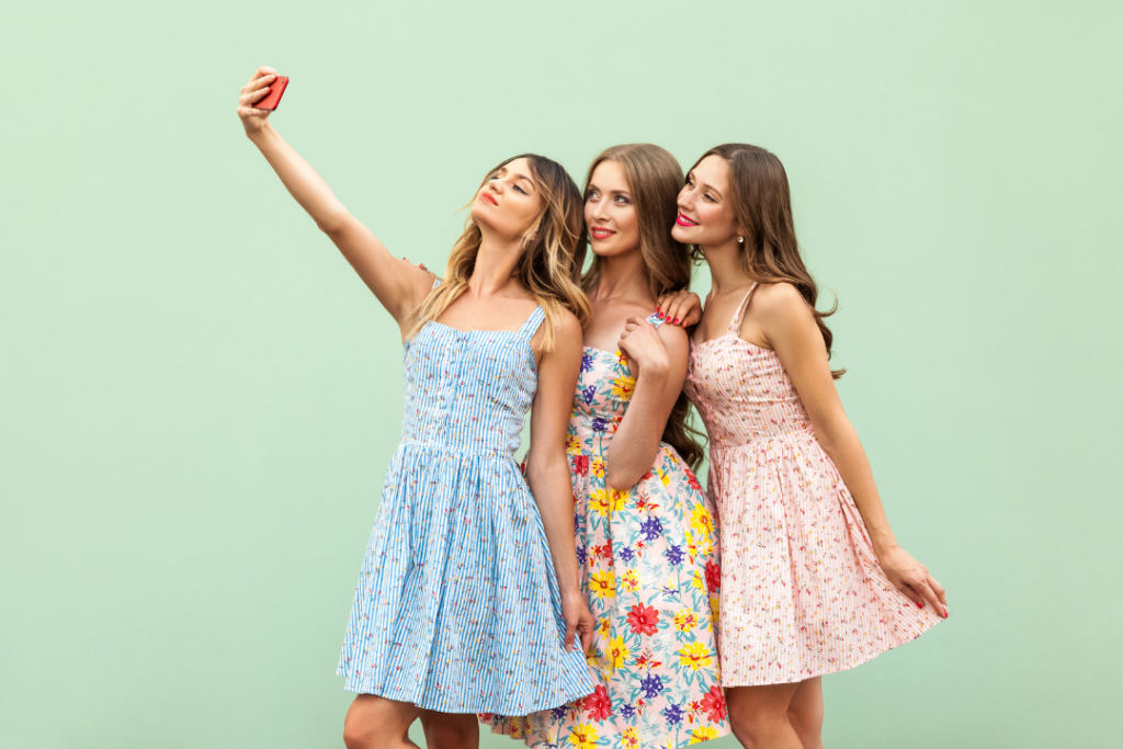 Woman taking photo with friends