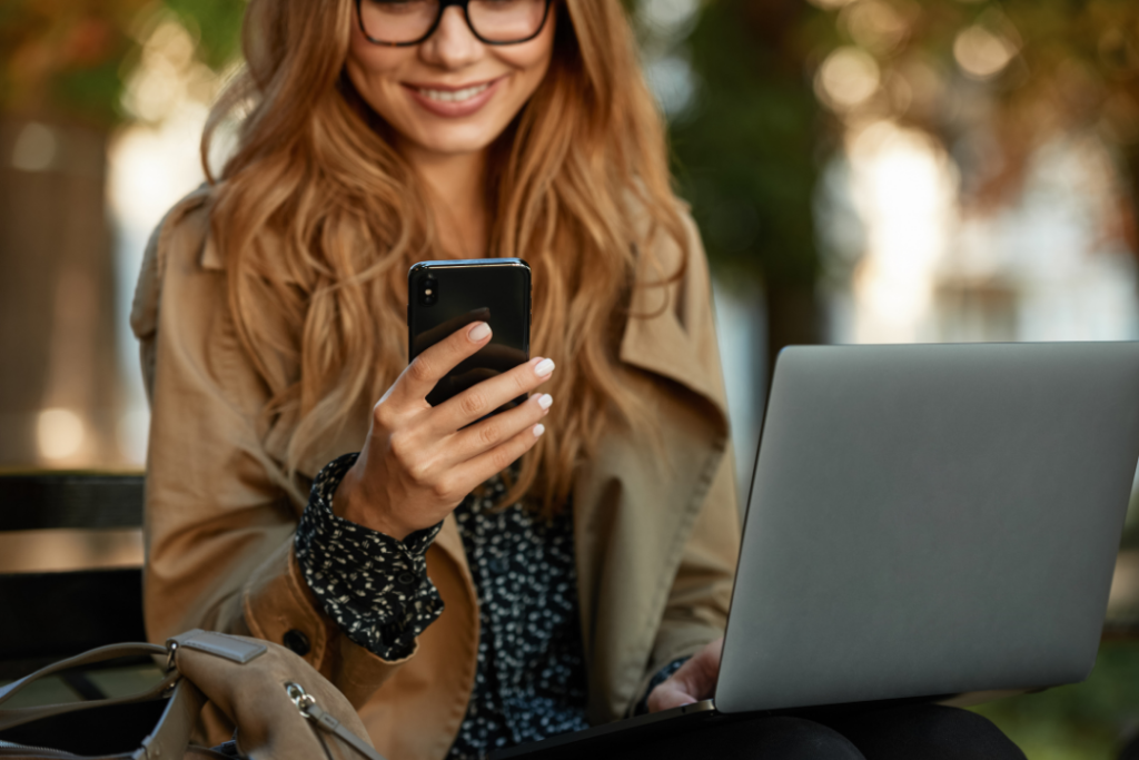 Photo of a woman using a smartphone