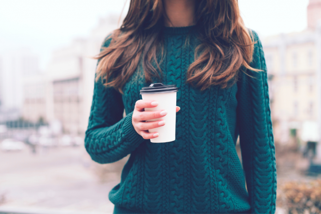 Woman holding a coffee