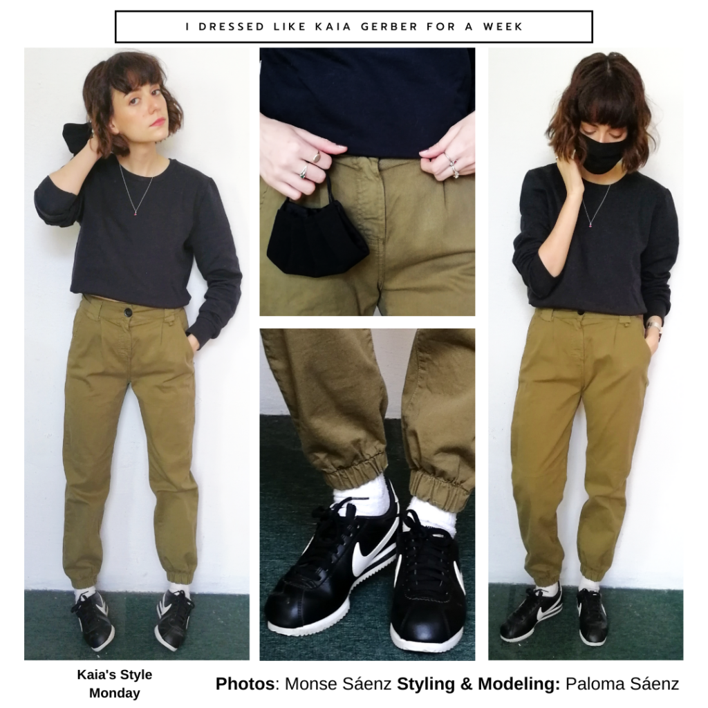 Outfit inspired by Kaia Gerber with green army pants, black cropped top, black Nike sneakers, black face mask