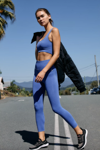 Free People blue workout set with sports bra and matching leggings with ribbed trim