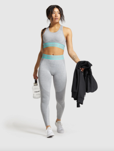 Gymshark sports bra and tights workout set in grey with torquoise trim