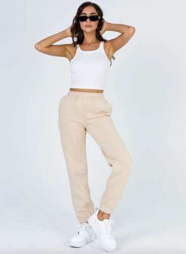 Pale beige sweatpants with cuffed bottoms