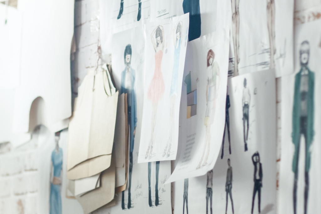 Fashion sketches pinned to a wall