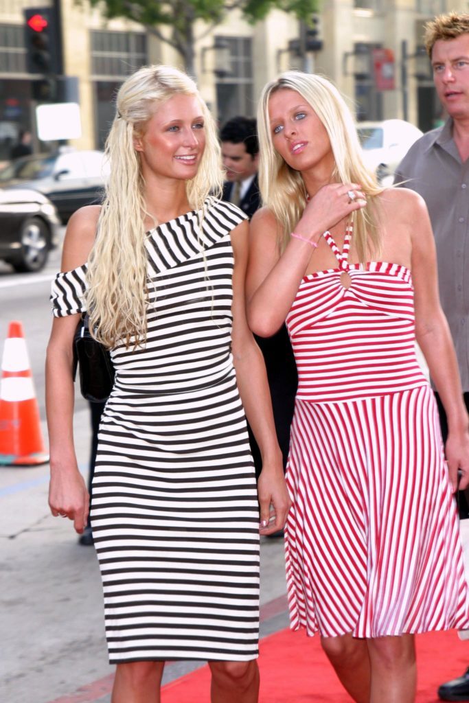 Paris and Nicky Hilton in 2003 in matching striped outfits