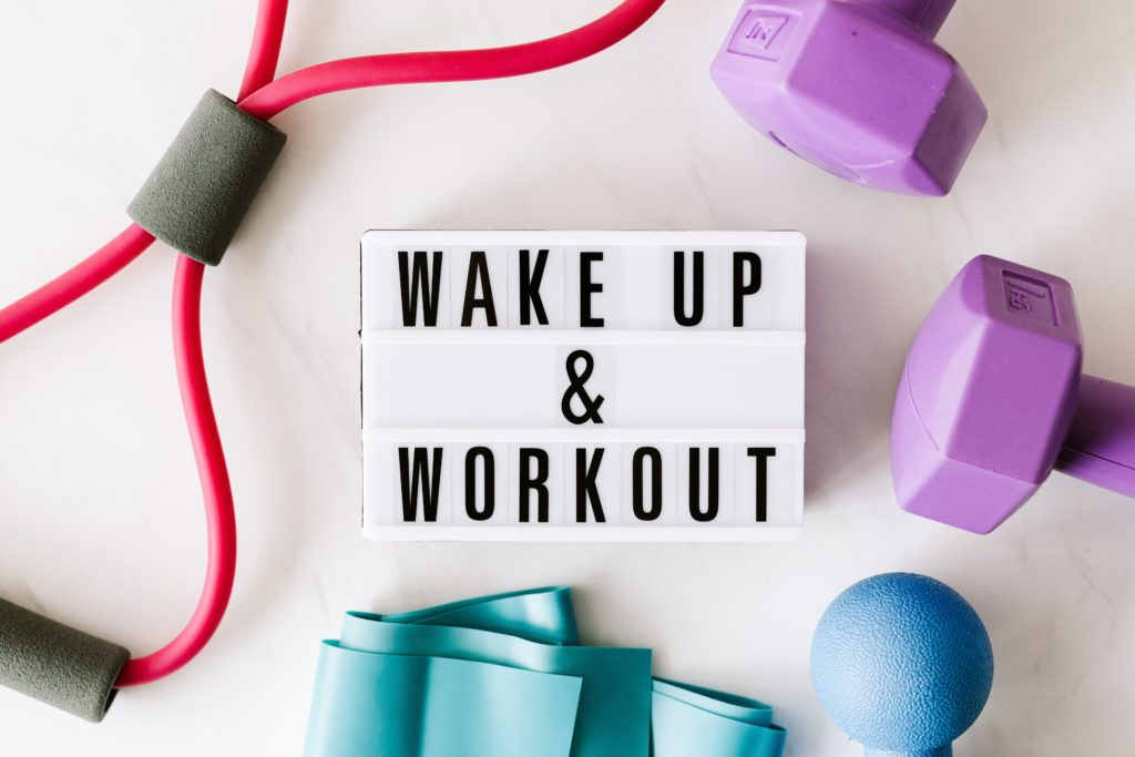 Workout gear surrounding a sign that says