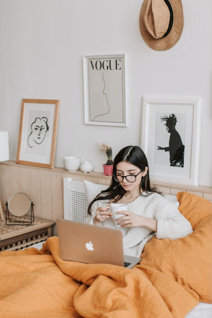 College student working from her bed, photo by Vlada Karpovich from Pexels