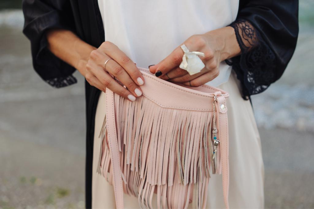 Woman holding a fringe bag
