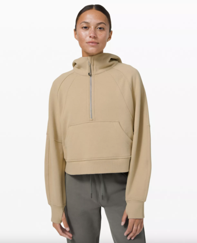 Lululemon shopping tips: light tan zip-up hoodie with hair tie attached to zipper.