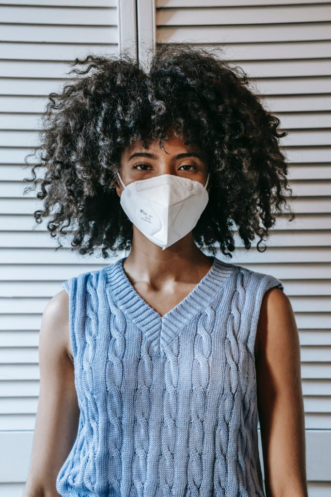Photo of a woman wearing a sweater vest and a face mask, from Sora Shimazaki from Pexels.
