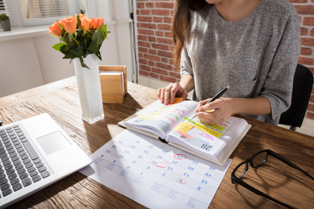Woman writing down her schedule