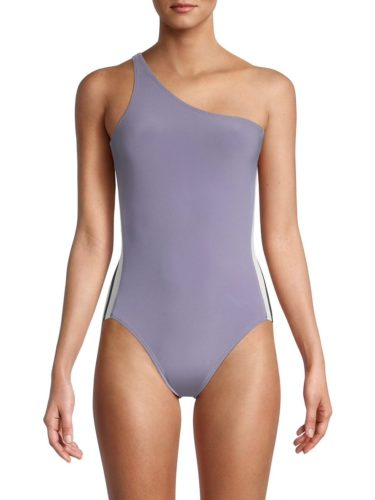 Dusty blue one piece bathing suit with asymmetrical neckline and white stripes on the sides