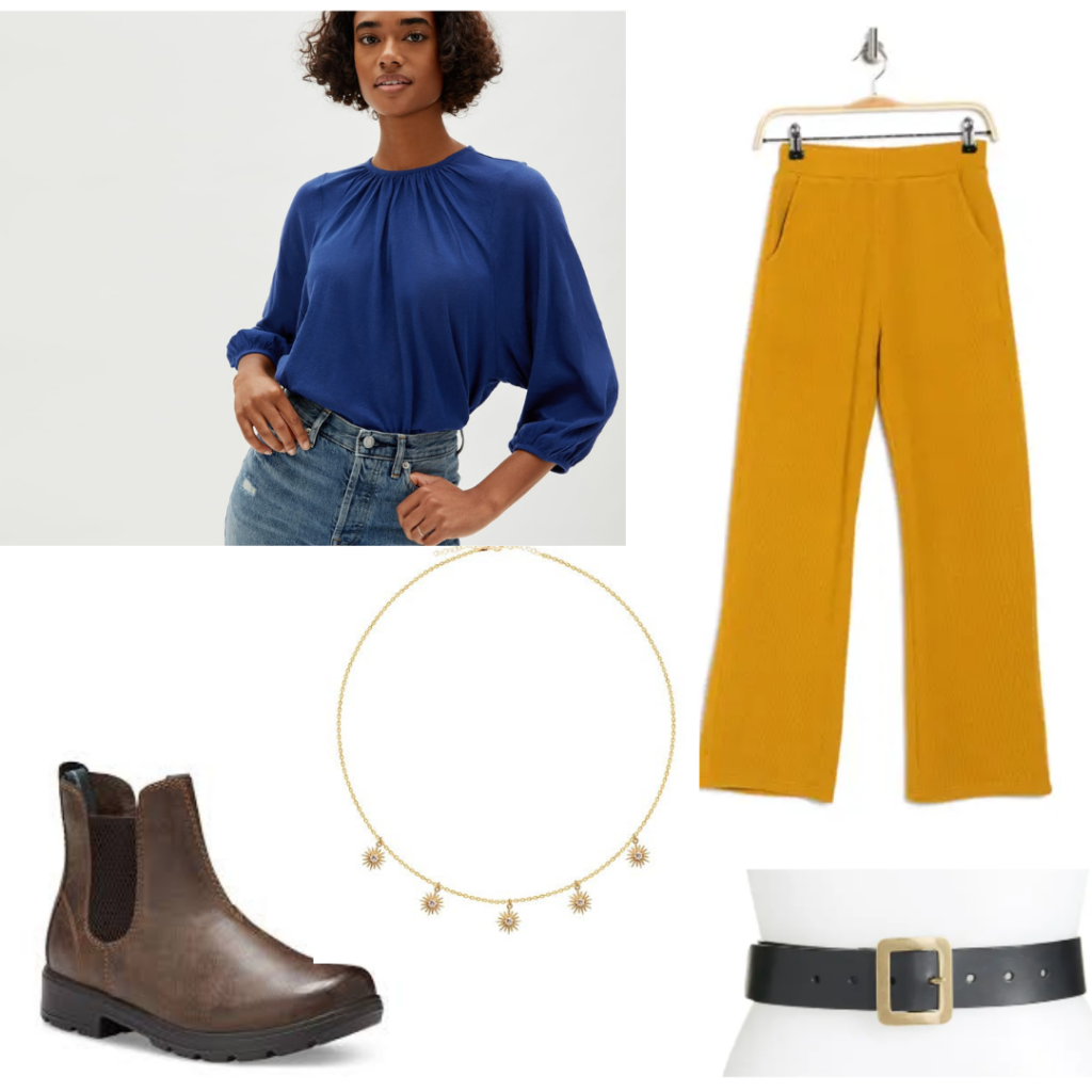 Alina Starkov Outfit with a blue blouse, yellow pants, brown boots, belt, and sun charm necklace.