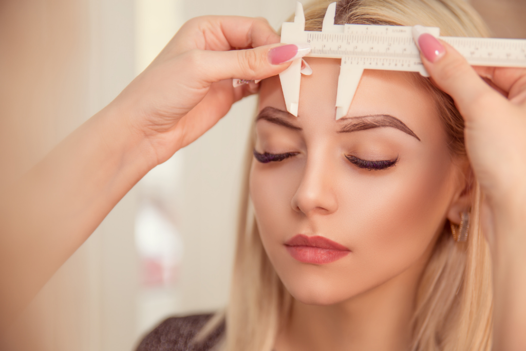 Woman getting her brows done for perfect eyebrows