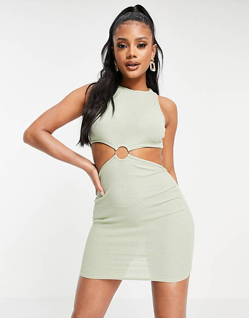 How to wear the cut out fashion trend: Cutout dress in sage