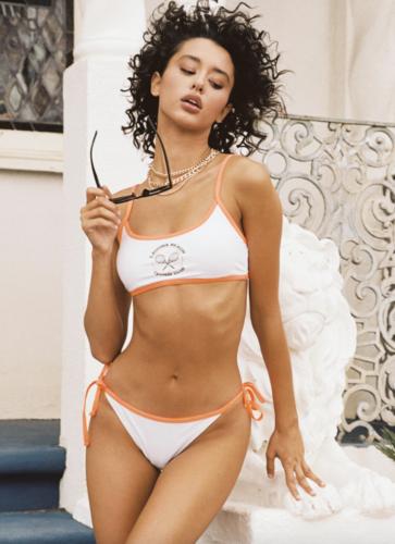 sporty white and orange bikini from Princess Polly