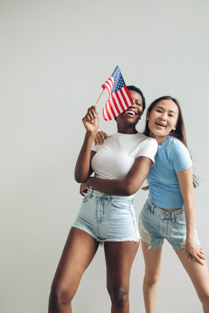 Fourth of July outfits guide - photo of two women celebrating July 4th