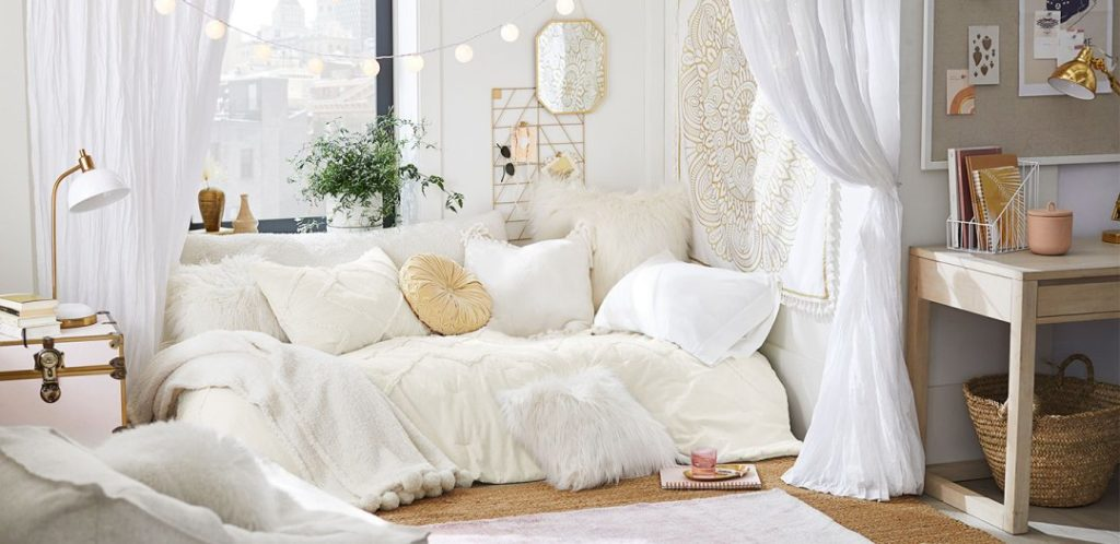 Cream dorm room with gold accents from pb teen