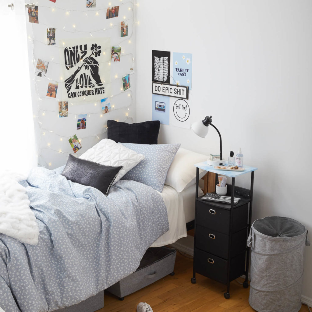 Blue, black and gray dorm room from Dormify
