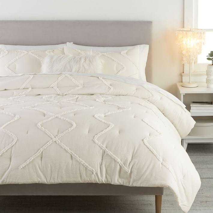Tufted cream comforter from Pbdorm