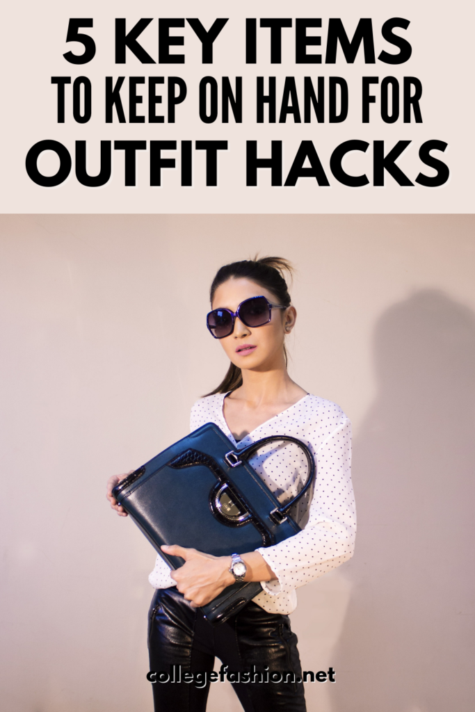 5 items to keep on hand for outfit hacks, from safety pins to fashion tape | Photo of a woman holding a handbag in front of her body while wearing a fashionable outfit