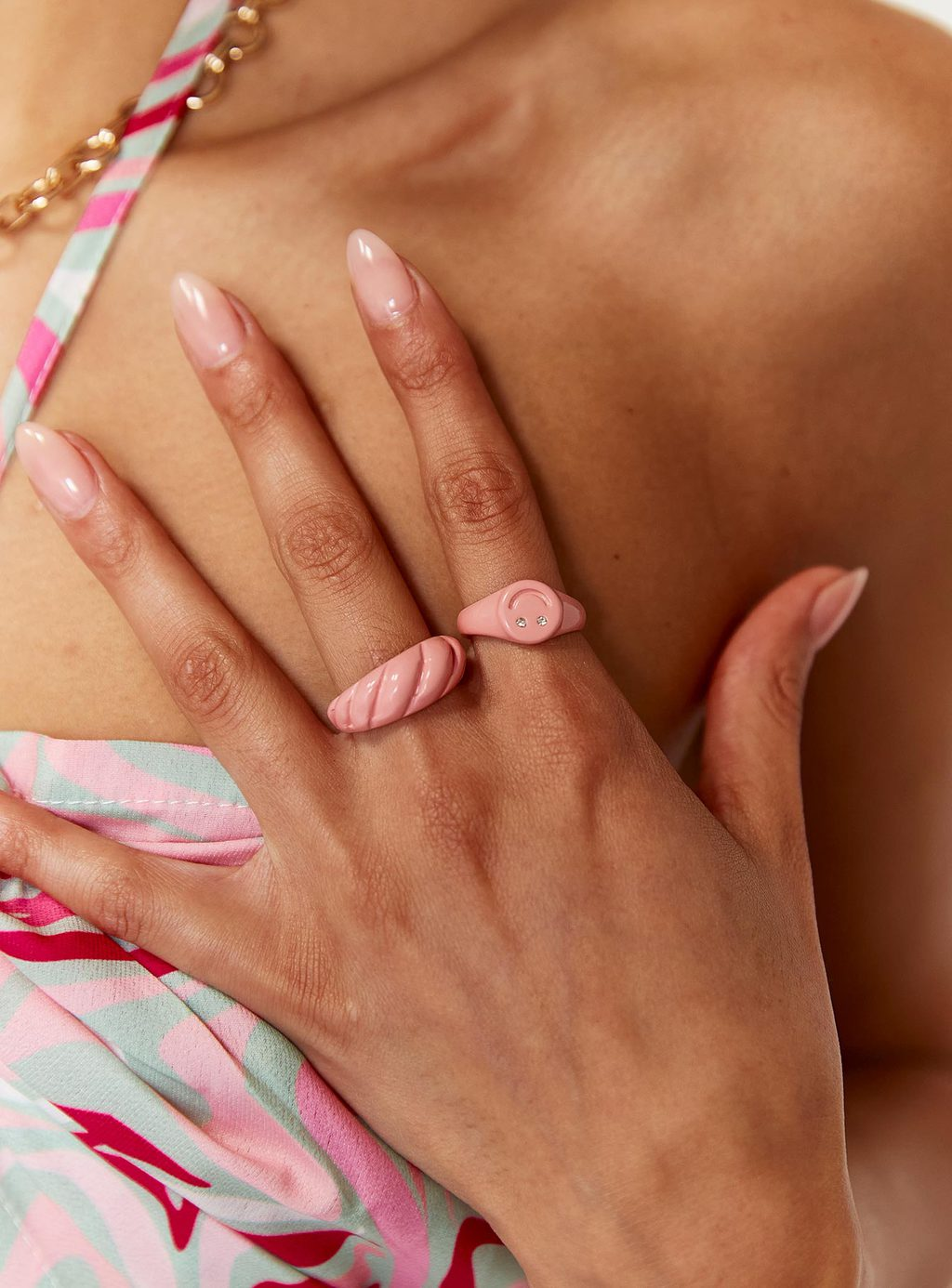 The hottest fall jewelry trends - photo of some pink enamel rings from Princess Polly