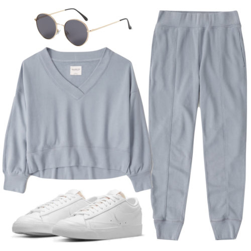Casual Athleisure Outfit with slate blue joggers and matching sweater, white sneakers, aviator sunglasses