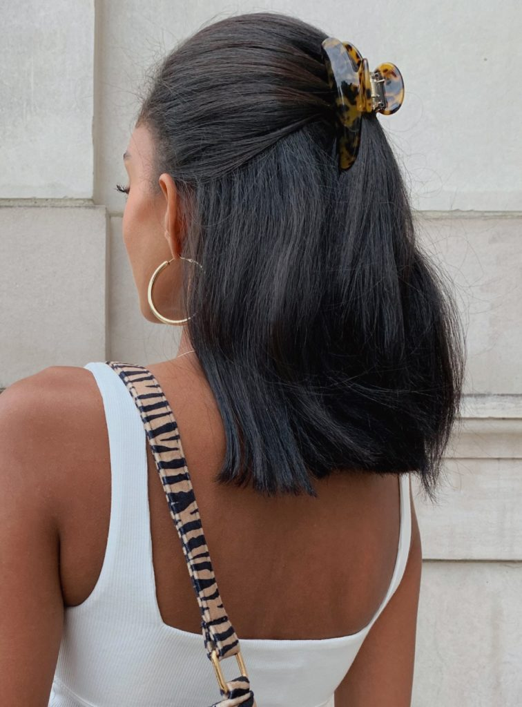 Cute hairstyles for short hair - photo of a woman wearing her short hair half up in a claw clip