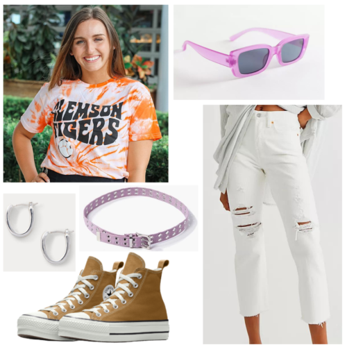 College game day outfit with tie dye team t-shirt, white ripped jeans, high top brown Converse, purple sunglasses and belt, silver earrings