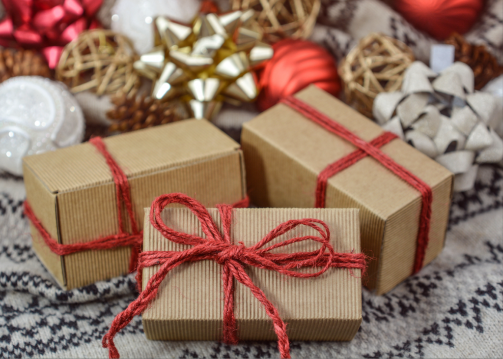 presents wrapped in brown paper with red rope bows