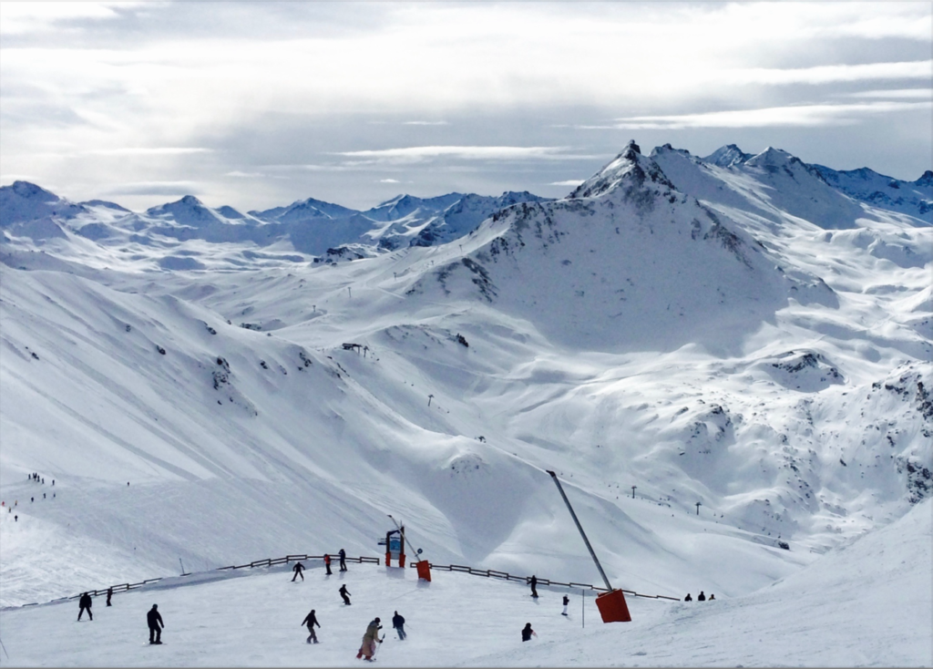 Skiiiers on snowcapped mountains