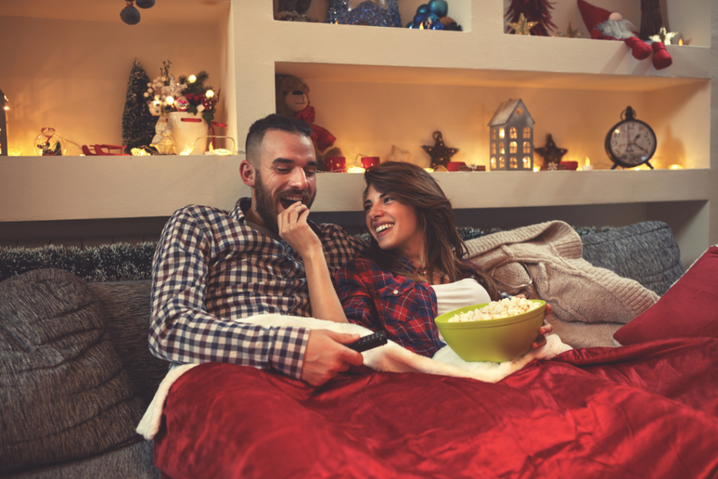 Couple watching holiday movies together