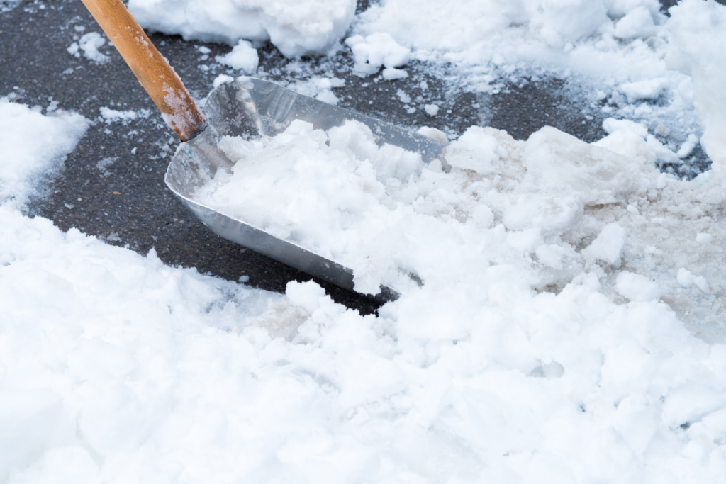 Photo of a shovel scooping up snow