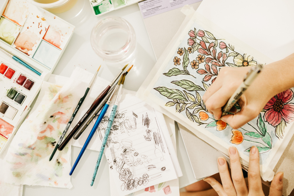 Woman drawing flowers